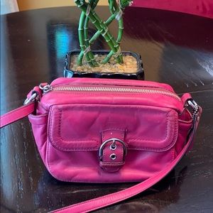 Used small hot pink coach bag.